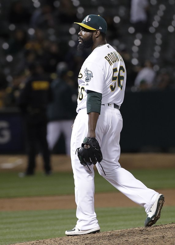 Oakland Athletics pitcher Fernando Rodney walks toward the dugout after being removed during the ninth inning of the team's baseball game against the Boston Red Sox in Oakland, Calif. (AP Photo/Jeff Chiu)