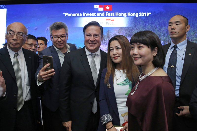 FILE - In this Tuesday, April 2, 2019, file photo, Panama's President Juan Carlos Varela Rodríguez, center, poses with his guests after a conference on the