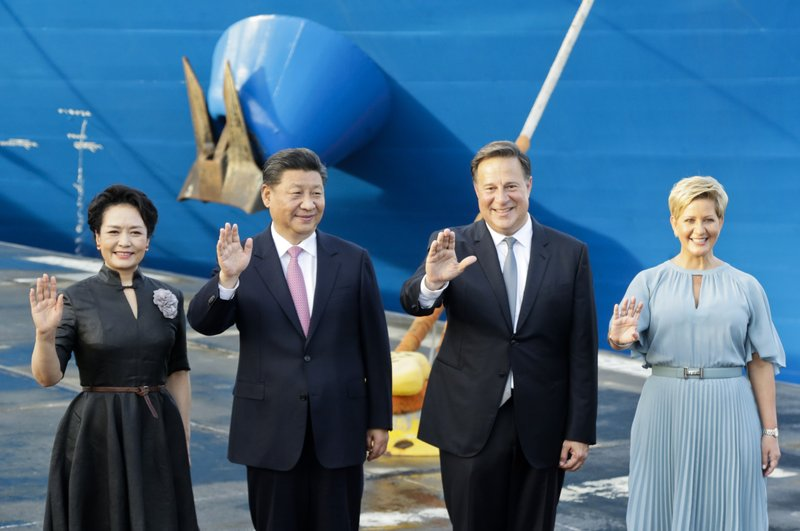 FILE - In this Dec. 3, 2018, file photo, from left, China's first lady Peng Liyuan, President Xi Jinping, Panama's President Juan Carlos Varela and first lady Lorena Castillo, wave as they pose for an official photo at the Panama Canal's Cocoli locks, in Panama City. (AP Photo/Arnulfo Franco, File)