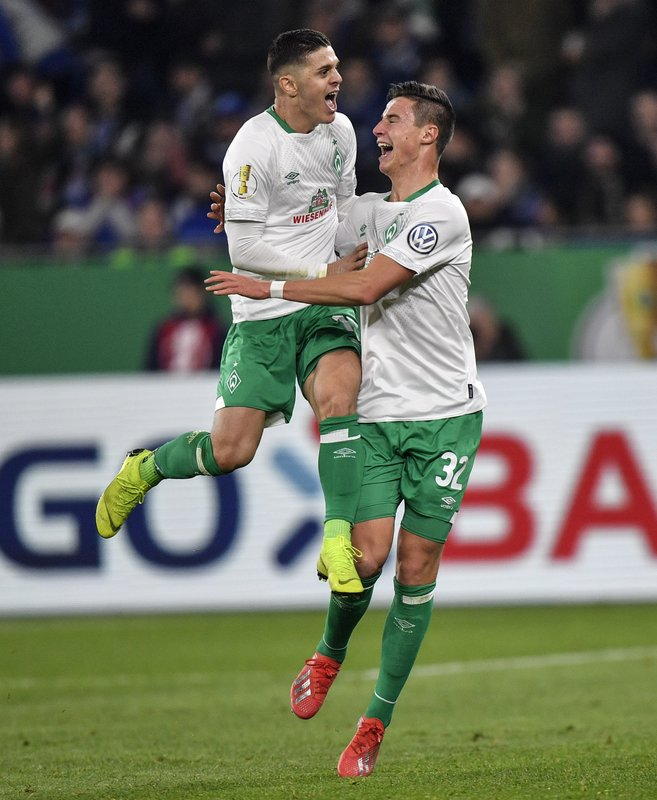 Bremen's Milot Rashica, left, celebrates after scoring the opening goal with Bremen's Marco Friedl, right, during the German soccer cup, DFB Pokal, quarterfinal match between FC Schalke 04 and Werder Bremen in Gelsenkirchen, Germany, Wednesday, April 3, 2019. (AP Photo/Martin Meissner)
