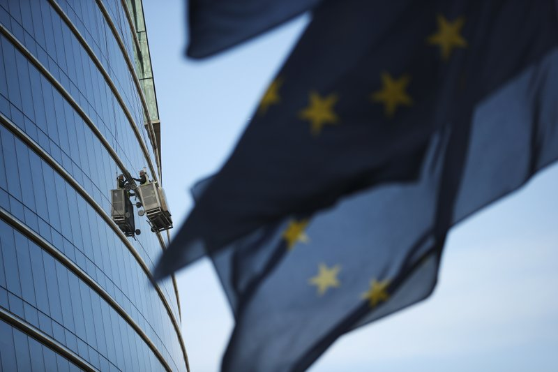 Window cleaners work on a building at the European Union headquarters area in Brussels, Thursday, April 4, 2019. (AP Photo/Francisco Seco)