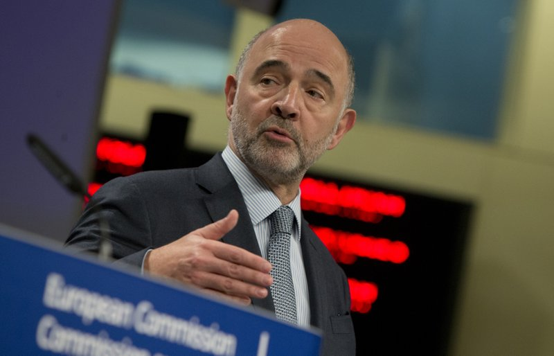 European Commissioner for Economic and Financial Affairs Pierre Moscovici speaks during a media conference regarding contingency planning on preparedness methods for customs at EU headquarters in Brussels, Wednesday, April 3, 2019. (AP Photo/Virginia Mayo)