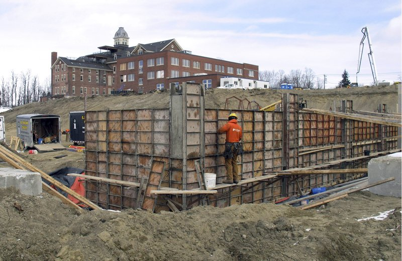 In this March 7, 2019 photo, construction continues on the property that once housed Burlington College, and before that was an orphanage run by the Roman Catholic Diocese, in Burlington, Vt. (AP Photo/Wilson Ring)