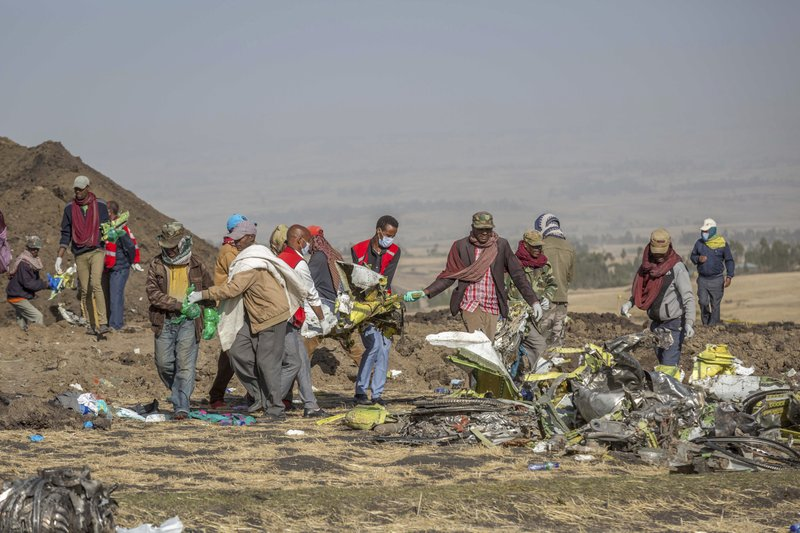 FILE - In this Monday March 11, 2019 file photo, rescuers work at the scene of an Ethiopian Airlines flight crash near Bishoftu, or Debre Zeit, south of Addis Ababa, Ethiopia. (AP Photo/Mulugeta Ayene, File)