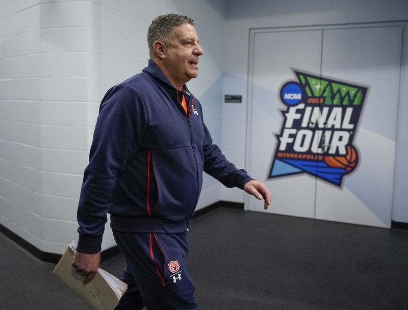 Auburn head coach Bruce Pearl walks to a news conference after a practice session for the semifinals of the Final Four NCAA college basketball tournament, Thursday, April 4, 2019, in Minneapolis. (AP Photo/David J. Phillip)
