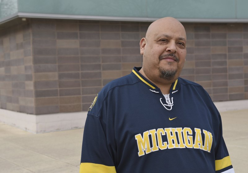 In this April 3, 2019 photo José Casas, assistant professor of theatre and drama at The Unversity of Michigan poses for a photo outside the Arthur Miller Theater in Ann Arbor, Mich. (Peter Smith/U-M School of Music Theatre & Dance via AP)