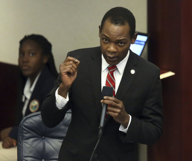 Rep. Al Jacquet, D-Lantana, asks a question about the budget during session Thursday April 4, 2019, in Tallahassee, Fla. (AP Photo/Steve Cannon)