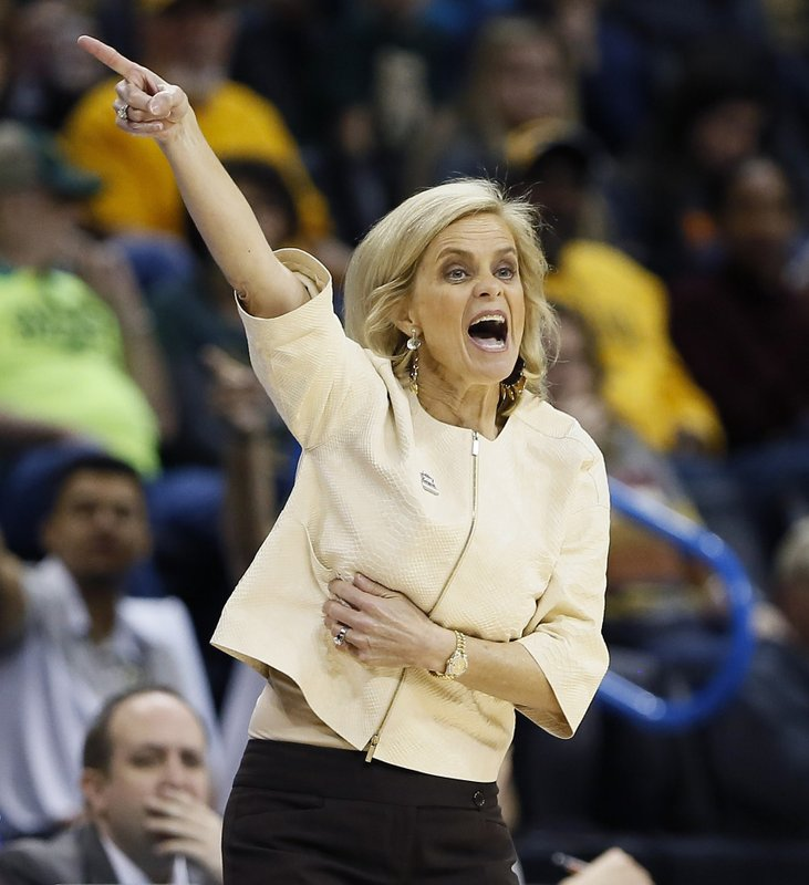 FILE - In this March 10, 2019, file photo, Baylor head coach Kim Mulkey coaches her team against Kansas State during the first half of an NCAA college basketball game in the Big 12 women's conference tournament, in Oklahoma City. (AP Photo/Alonzo Adams, File)