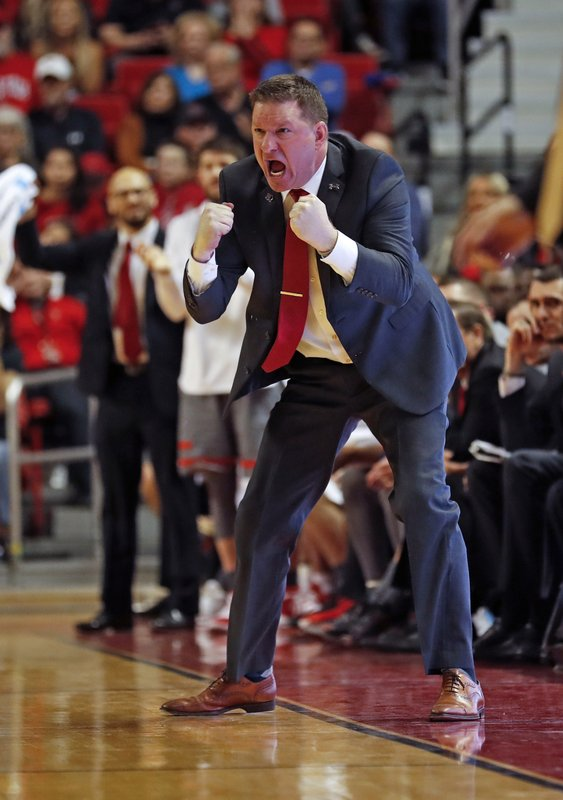 FILE - In this Feb. 16, 2019, file photo, Texas Tech coach Chris Beard yells at his players during the second half of an NCAA college basketball game against Baylor, in Lubbock, Texas. (AP Photo/Brad Tollefson, File)