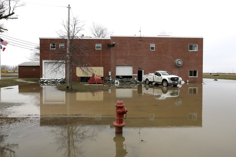 The Glenwood, Iowa, water plant stands in flood waters Wednesday, April 3, 2019. Glenwood's wells and water-treatment plant were inundated by flood waters and are now being repaired and tested. (AP Photo/Nati Harnik)