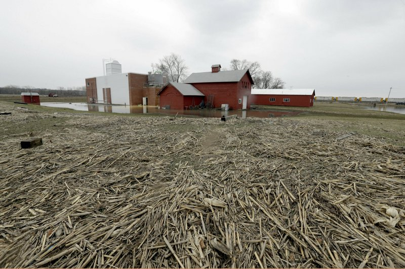 The Glenwood, Iowa, water plant stands in flood waters as corn stalks washed by the floods cover the surrounding area Wednesday, April 3, 2019. (AP Photo/Nati Harnik)