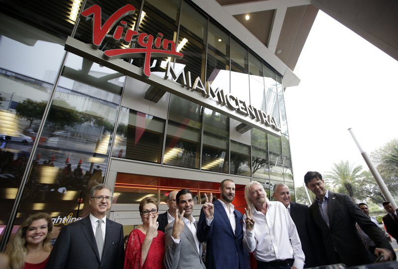 Richard Branson, of Virgin Group, third from right, poses with officials at a naming ceremony for the Brightline train station, to be renamed as Virgin MiamiCentral, Thursday, April 4, 2019, in Miami. (AP Photo/Lynne Sladky)