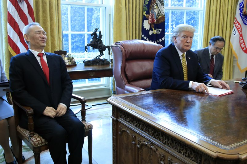 President Donald Trump meets China's Vice Premier Liu He in the Oval Office of the White House in Washington, Thursday, April 4, 2019. (AP Photo/Manuel Balce Ceneta)