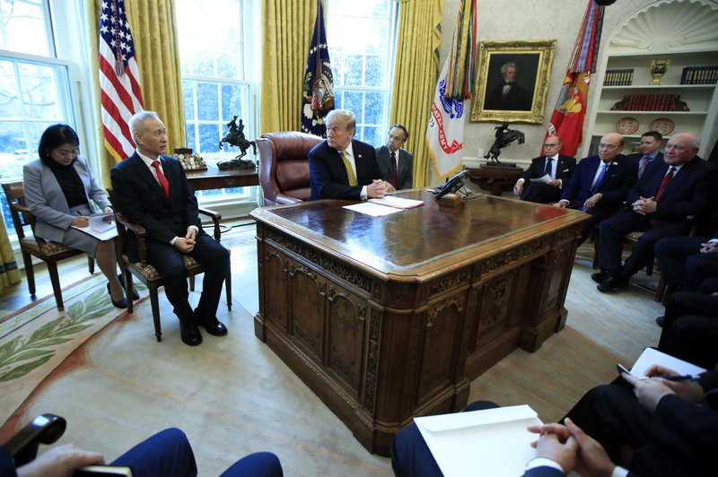 President Donald Trump listens to China's Vice Premier Liu He, front left, speak during their meeting in the Oval Office of the White House in Washington, Thursday, April 4, 2019. (AP Photo/Manuel Balce Ceneta)