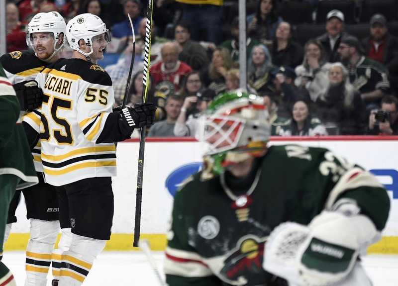 Boston Bruins' Noel Acciari (55) congratulates Joakim Nordstrom (20), of Sweden, for scoring a goal as Minnesota Wild goaltender Alex Stalock (32) watches during the second period of an NHL hockey game Thursday, April 4, 2019, in St. (AP Photo/Hannah Foslien)