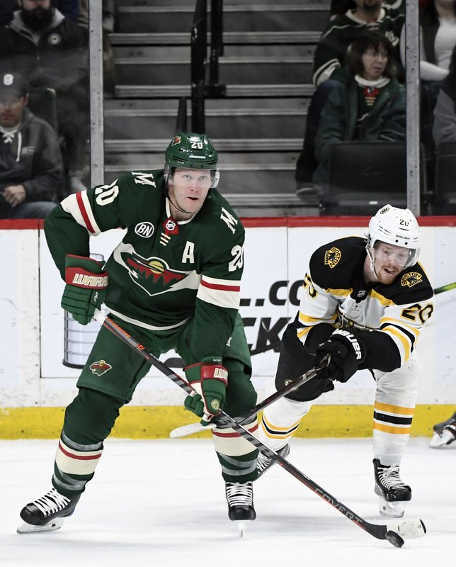 Minnesota Wild Ryan Suter (20) passes away from Boston Bruins' Joakim Nordstrom (20), of Sweden, during the first period of an NHL hockey game Thursday, April 4, 2019, in St. (AP Photo/Hannah Foslien)