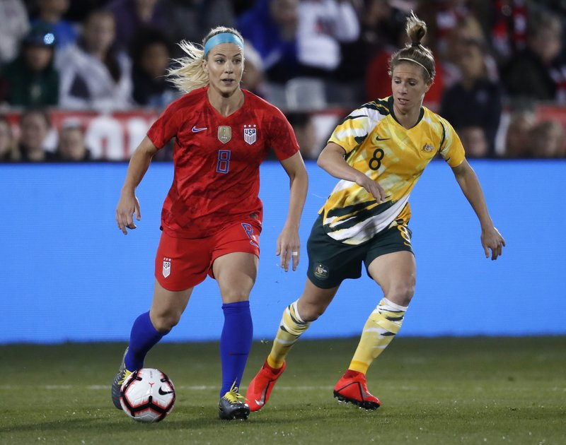 United States midfielder Julie Ertz, left, looks to pass the ball as Australia midfielder Elise Kellogg-Knight pursues during the first half of a friendly soccer match Thursday, April 4, 2019, in Commerce City, Colo. (AP Photo/David Zalubowski)