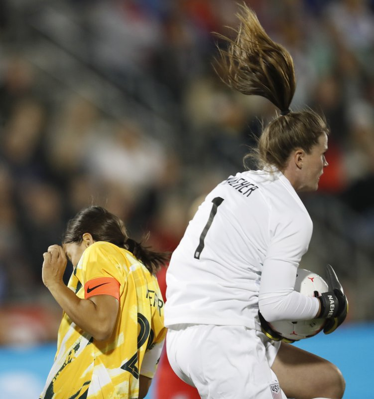 United States goalie Alyssa Naeher, front, makes a stop as Australia forward Sam Kerr avoids colliding with Naeher during the first half of a friendly soccer match Thursday, April 4, 2019, in Commerce City, Colo. (AP Photo/David Zalubowski)