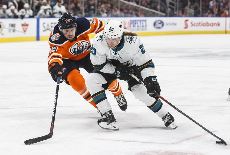 San Jose Sharks' Marcus Sorensen (20) is chased by Edmonton Oilers' Leon Draisaitl (29) during the first period of an NHL hockey game Thursday, April 4, 2019, in Edmonton, Alberta. (Jason Franson/The Canadian Press via AP)