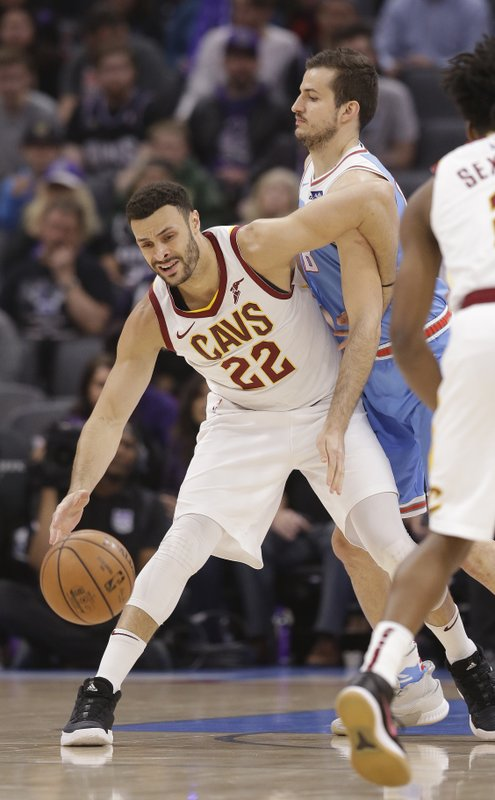 Cleveland Cavaliers forward Larry Nance Jr., left, is fouled by Sacramento Kings forward Nemanja Bjelica during the first quarter of an NBA basketball game Thursday, April 4, 2019, in Sacramento, Calif. (AP Photo/Rich Pedroncelli)