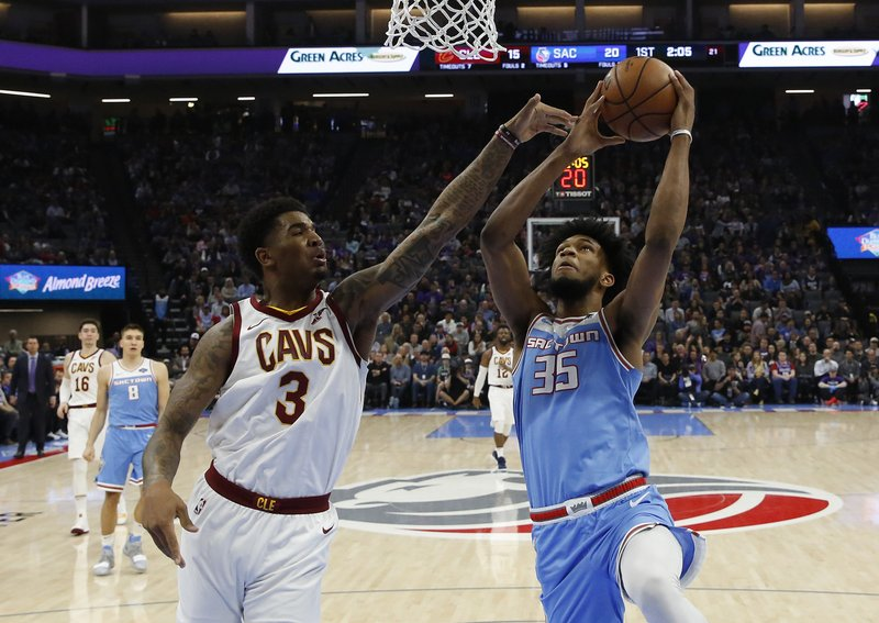 Sacramento Kings forward Marvin Bagley III, right, goes to the basket against Cleveland Cavaliers forward Marquese Chriss during the first quarter of an NBA basketball game Thursday, April 4, 2019, in Sacramento, Calif. (AP Photo/Rich Pedroncelli)