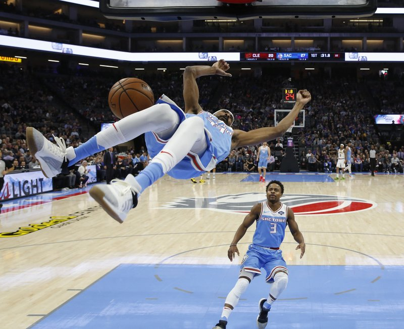 Sacramento Kings guard Corey Brewer flips through the air after scoring on a breakaway dunk, as teammate Yogi Ferrell, right, watches during the first quarter of the team's NBA basketball game against the Cleveland Cavaliers on Thursday, April 4, 2019, in Sacramento, Calif. (AP Photo/Rich Pedroncelli)