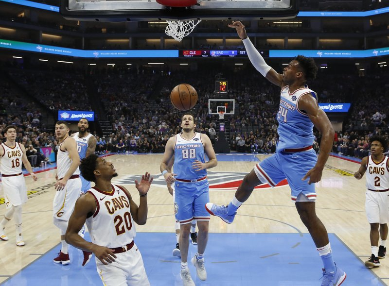 Sacramento Kings guard Buddy Hield dunks over Cleveland Cavaliers guard Brandon Knight (20) during the first quarter of an NBA basketball game Thursday, April 4, 2019, in Sacramento, Calif. (AP Photo/Rich Pedroncelli)