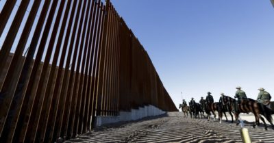 Illegal immigrants failed to climb a new border barrier and arrested at the Mexico-U.S. border