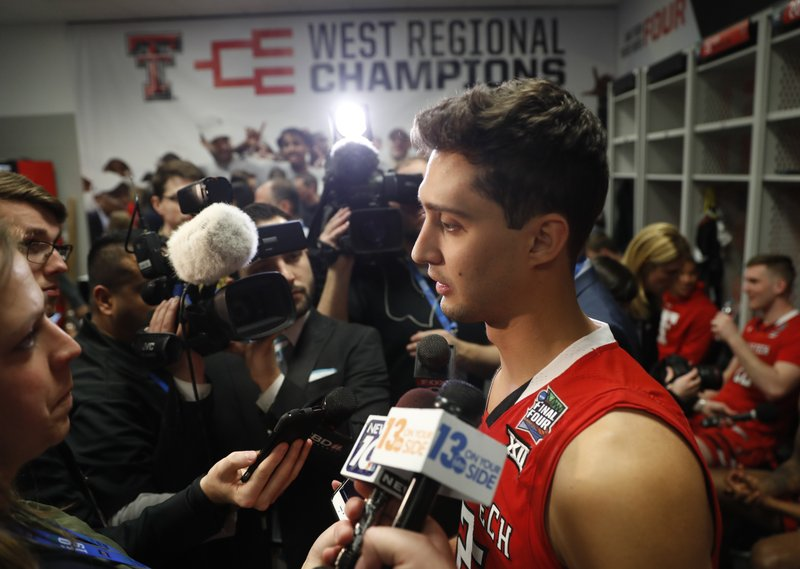 Texas Tech's Davide Moretti answers questions after a practice session for the semifinals of the Final Four NCAA college basketball tournament, Thursday, April 4, 2019, in Minneapolis. (AP Photo/Jeff Roberson)