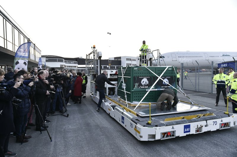 The boxes carrying two Giant Pandas named Xing Er and Mao Sun is unloaded from the plane on its arrival at Copenhagen Airport, Thursday April 4, 2019. (Liselotte Sabroe/Ritzau Scanpix via AP)