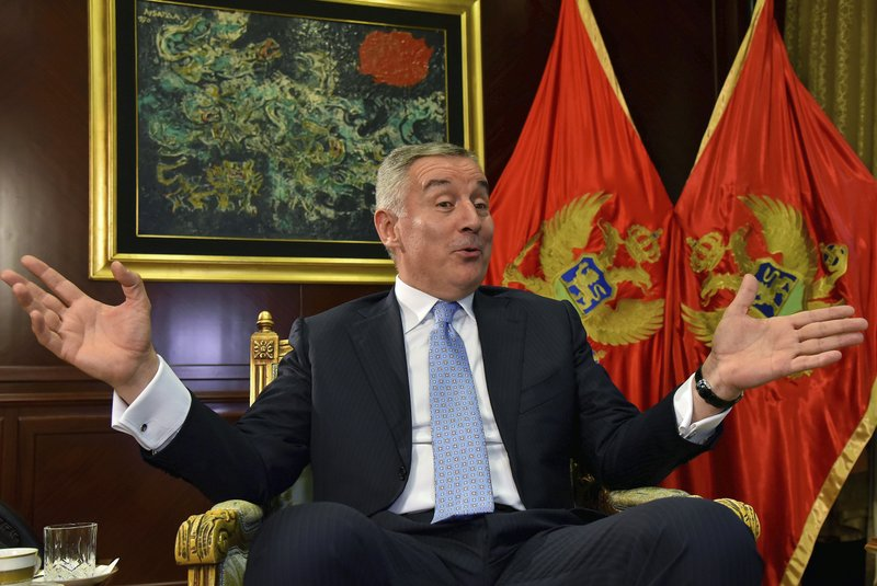 Montenegro President Milo Djukanovic speaks and gestures during an interview with The Associated Press in Montenegro's capital Podgorica, Thursday, April 4, 2019. (AP Photo/Risto Bozovic)