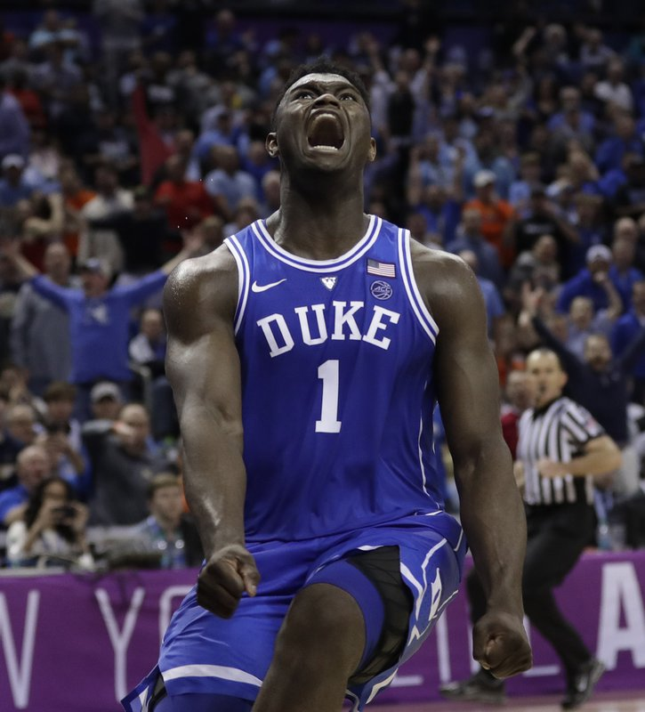 FILE - In this March 15, 2019, file photo, Duke's Zion Williamson (1) reacts after a dunk against North Carolina during the second half of an NCAA college basketball game in the Atlantic Coast Conference tournament, in Charlotte, N. (AP Photo/Nell Redmond, File)