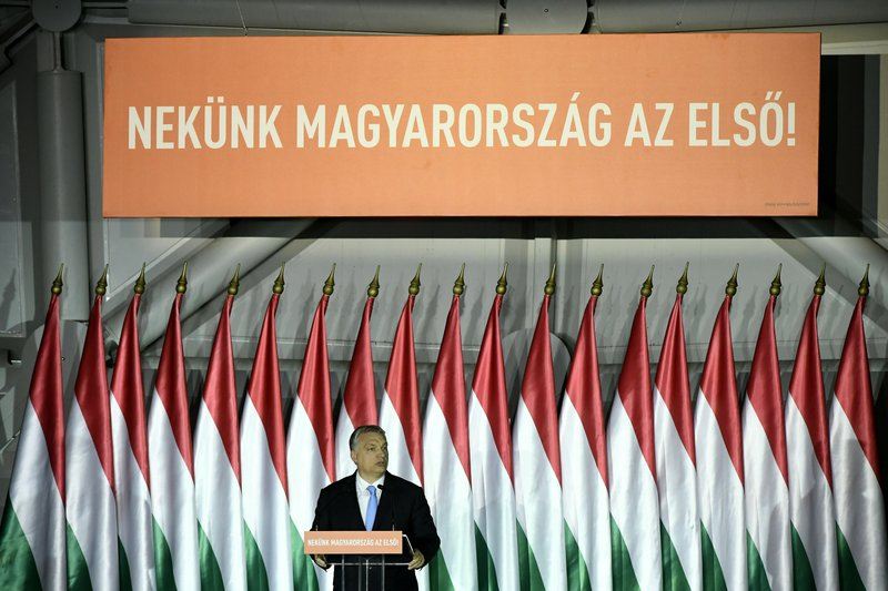 Hungarian Prime Minister Viktor Orban addresses a meeting of the governing Fidesz party, in Budapest, Hungary, Friday, April 5, 2019. (Szilard Koszticsak/MTI via AP)
