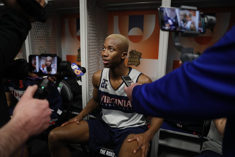 Virginia's Mamadi Diakite answers a question after a practice session for the semifinals of the Final Four NCAA college basketball tournament, Thursday, April 4, 2019, in Minneapolis. (AP Photo/Jeff Roberson)
