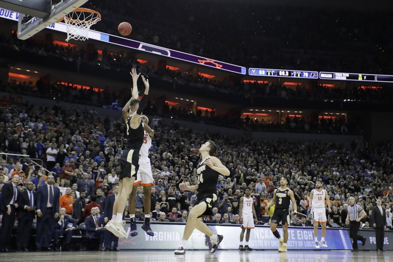Virginia's Mamadi Diakite (25) shoots over Purdue's Matt Haarms (32) at the buzzer to end the second half of the men's NCAA Tournament college basketball South Regional final game, Saturday, March 30, 2019, in Louisville, Ky. (AP Photo/Timothy D. Easley)