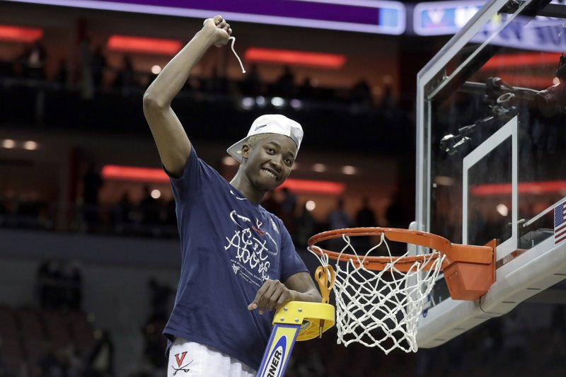 Virginia's Mamadi Diakite celebrates after Virginia defeated Purdue, 80-75, in overtime of the men's NCAA Tournament college basketball South Regional final game, Saturday, March 30, 2019, in Louisville, Ky. (AP Photo/Michael Conroy)