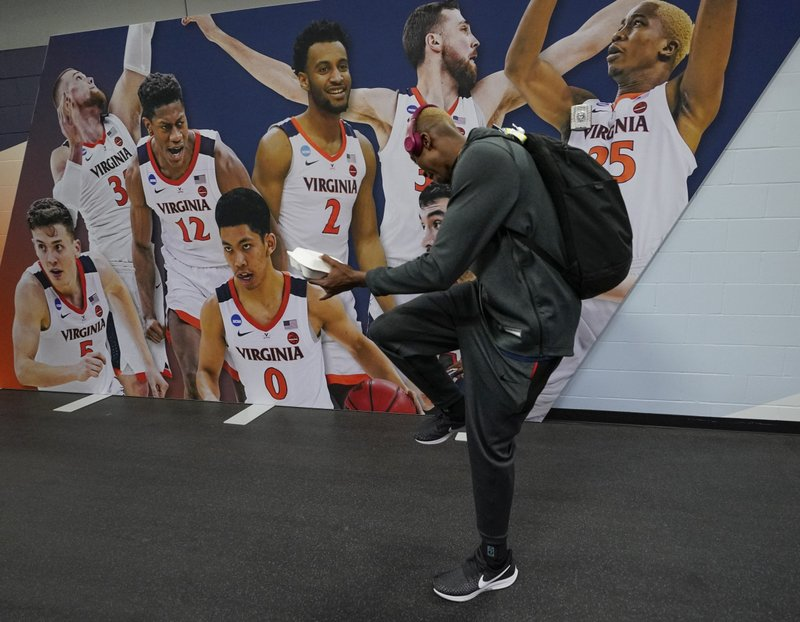 Virginia's Mamadi Diakite leaves the locker room after a practice session for the semifinals of the Final Four NCAA college basketball tournament, Thursday, April 4, 2019, in Minneapolis. (AP Photo/David J. Phillip)