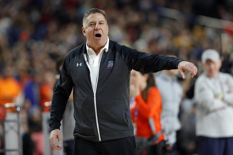 Auburn head coach Bruce Pearl directs his team during a practice session for the semifinals of the Final Four NCAA college basketball tournament, Friday, April 5, 2019, in Minneapolis. (AP Photo/Charlie Neibergall)