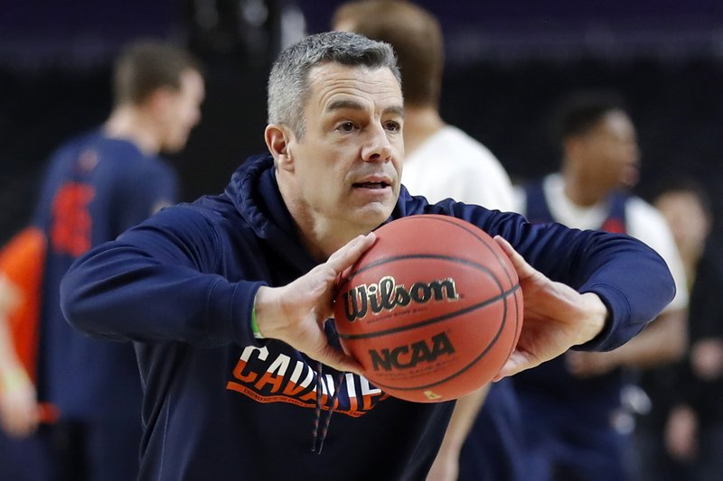 Virginia head coach Tony Bennett passes the ball during a practice session for the semifinals of the Final Four NCAA college basketball tournament, Friday, April 5, 2019, in Minneapolis. (AP Photo/Charlie Neibergall)