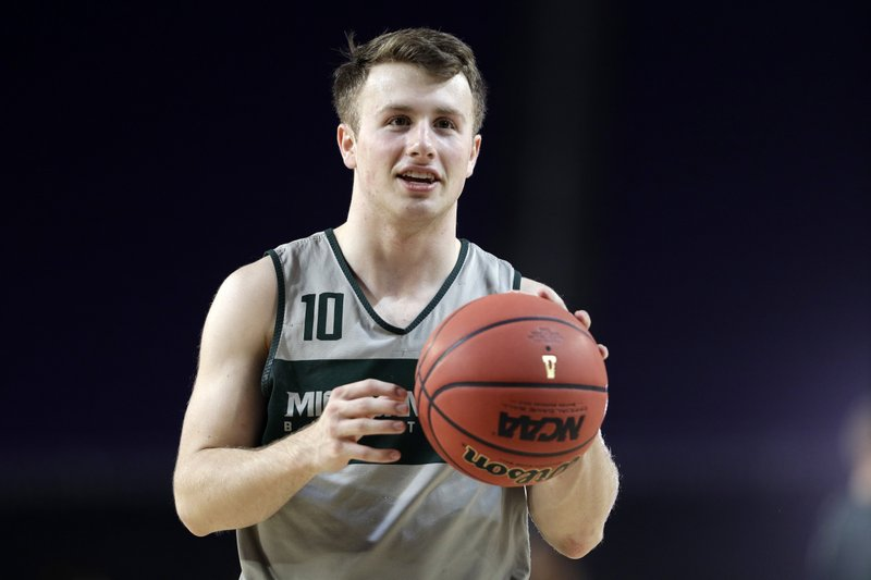 Michigan State's Jack Hoiberg (10) warms up during a practice session for the semifinals of the Final Four NCAA college basketball tournament, Friday, April 5, 2019, in Minneapolis. (AP Photo/David J. Phillip)