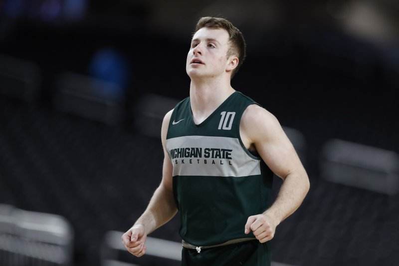 Michigan State guard Jack Hoiberg runs on the court during a practice session for the semifinals of the Final Four NCAA college basketball tournament, Friday, April 5, 2019, in Minneapolis. (AP Photo/Jeff Roberson)