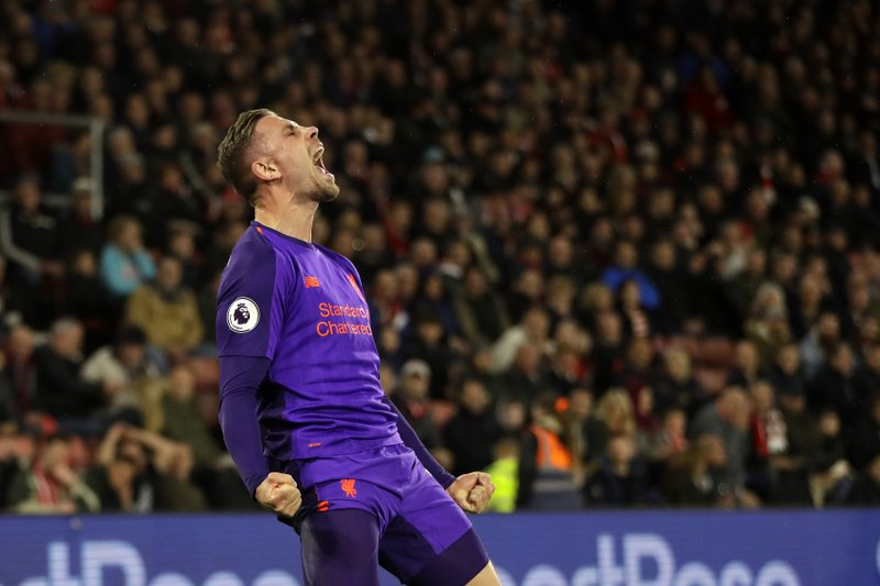 Liverpool's Jordan Henderson celebrates after scoring his side's third goal against Southampton during an English Premier League soccer match at St Mary's stadium in Southampton, England, Friday, April 5, 2019. (AP Photo/Kirsty Wigglesworth)