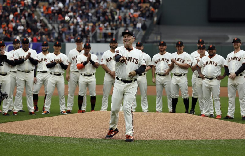 San Francisco Giants manager Bruce Bochy throws out the ceremonial first pitch before an opening day baseball game against the Tampa Bay Rays, Friday, April 5, 2019, in San Francisco. (AP Photo/Eric Risberg)