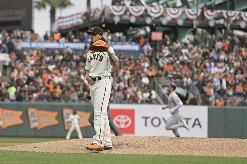 San Francisco Giants starting pitcher Dereck Rodriguez stands on the mound after giving up a home run to the Tampa Bay Rays' Kevin Kiermaier, back right, in the first inning of a baseball game Friday, April 5, 2019, in San Francisco. (AP Photo/Eric Risberg)