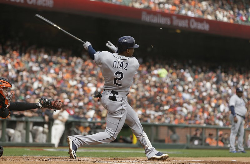 Tampa Bay Rays third baseman Yandy Diaz hits a two-run home run off San Francisco Giants starting pitcher Dereck Rodriguez in the first inning of a baseball game Friday, April 5, 2019, in San Francisco. (AP Photo/Eric Risberg)