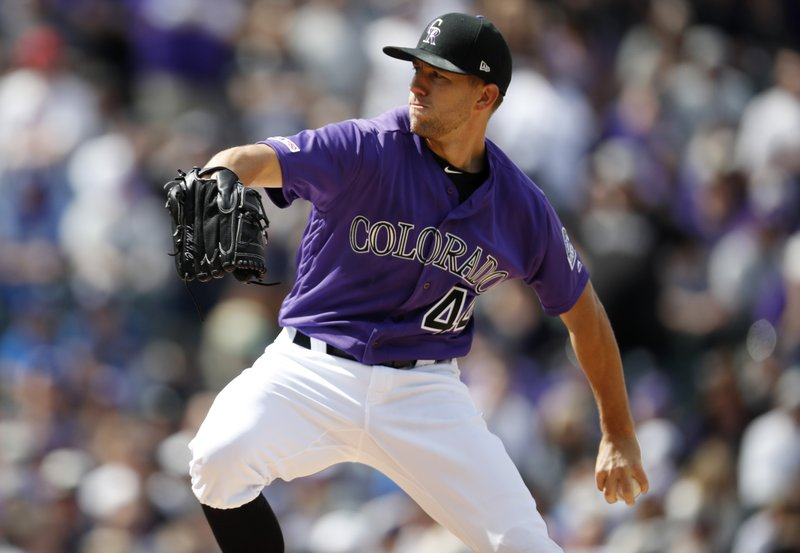 Colorado Rockies starting pitcher Tyler Anderson works against the Los Angeles Dodgers in the first inning of a baseball game Friday, April 5, 2019, in Denver. (AP Photo/David Zalubowski)