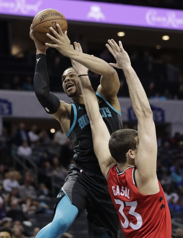 Charlotte Hornets' Miles Bridges, left, drives against Toronto Raptors' Marc Gasol, right, during the first half of an NBA basketball game in Charlotte, N. (AP Photo/Chuck Burton)