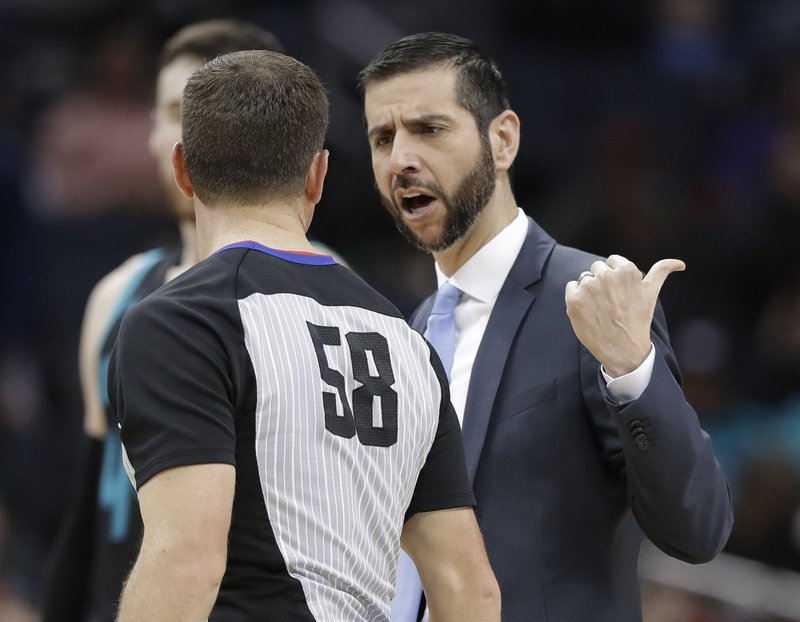 Charlotte Hornets coach James Borrego, right, argues a technical-foul call with referee Josh Tiven (58) during the first half of the team's NBA basketball game against the Toronto Raptors in Charlotte, N. (AP Photo/Chuck Burton)