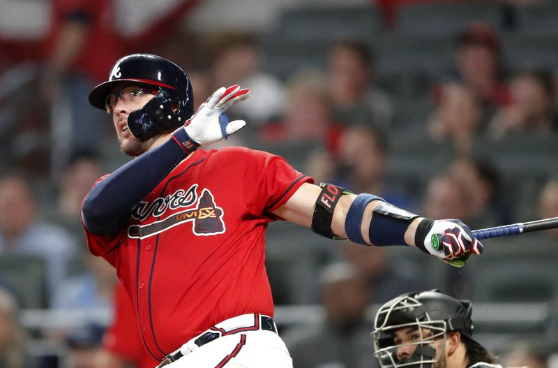 Atlanta Braves' Tyler Flowers watches his solo home run in the fourth inning of the team's baseball game against the Miami Marlins on Friday, April 5, 2019, in Atlanta. (AP Photo/John Bazemore)