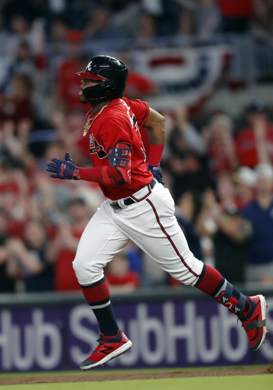 Atlanta Braves' Ronald Acuna Jr. rounds the bases after hitting a two-run home run during the fourth inning of the team's baseball game against the Miami Marlins on Friday, April 5, 2019, in Atlanta. (AP Photo/John Bazemore)